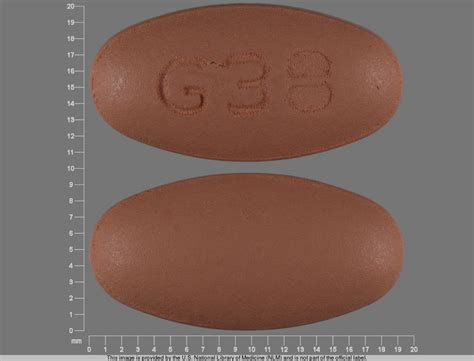 cream colored oval tablet with nc on it picture 1
