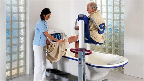 a nurse bathing a male patient. picture 5