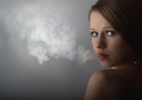 woman in cloud of cigarette smoke picture 11