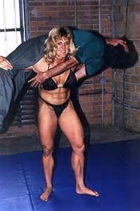 strong muscle girl dominates weak boy picture 5