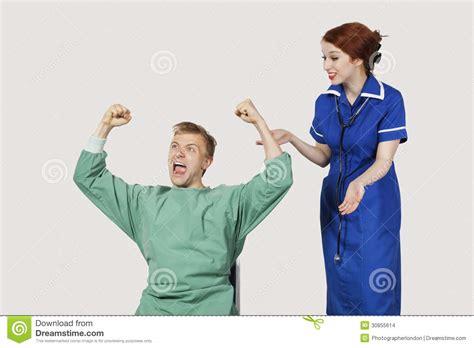 a nurse bathing a male patient. picture 7