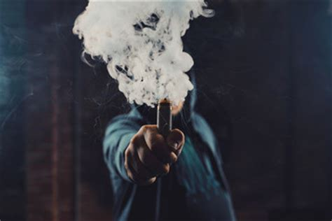 woman in cloud of cigarette smoke picture 4