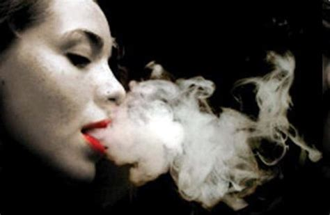 woman blowing smoke picture 1