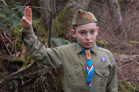 a boy from the scouts asked to touch picture 5
