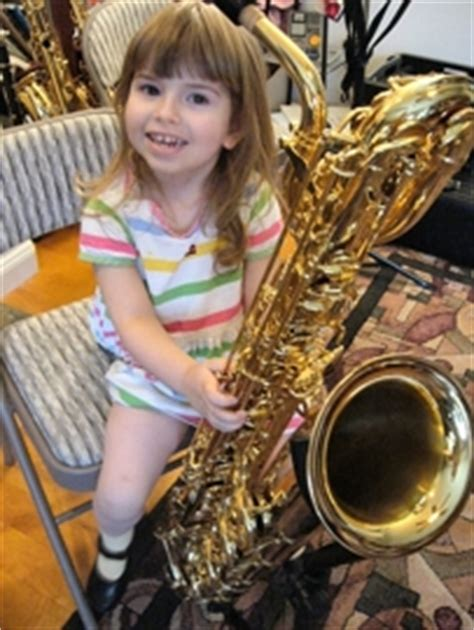 women sax with small boy picture 2