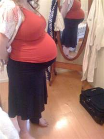 huge pregnant stomach with dectuplets picture 1