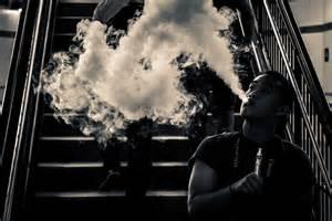 woman in cloud of cigarette smoke picture 7