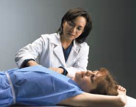 female doctor performing physical exam picture 2