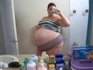 huge pregnant stomach with dectuplets picture 18