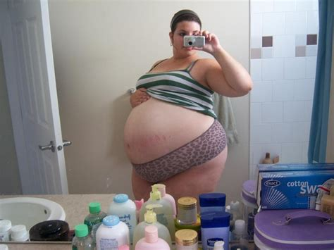huge pregnant stomach with dectuplets picture 7