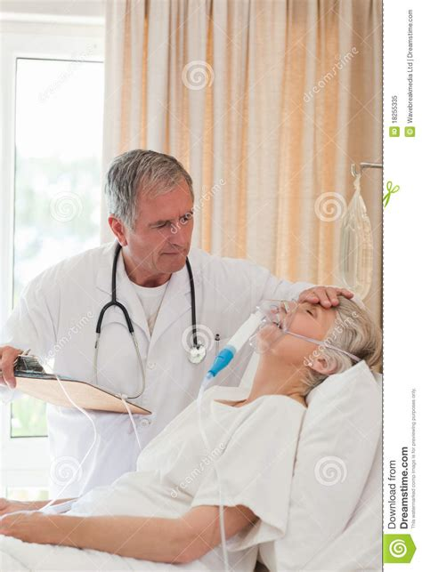 doctor examining his patient picture 1
