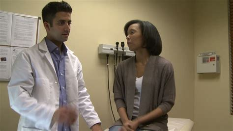 woman doctor examins male patient genital area picture 3