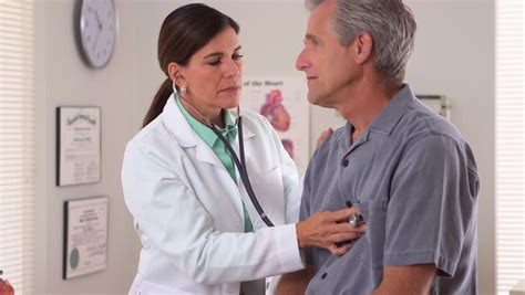 female doctor surprises male patient during physical picture 8