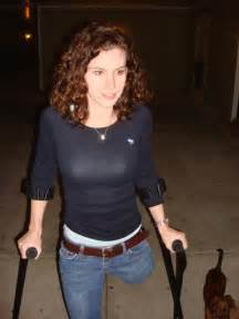 female leg amputee walking on crutches picture 4