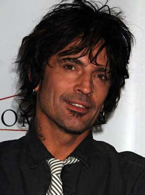 what is on tommy lee's tooth picture 11