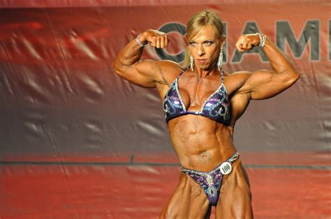 muscular female bodybuilder ing two guys picture 4