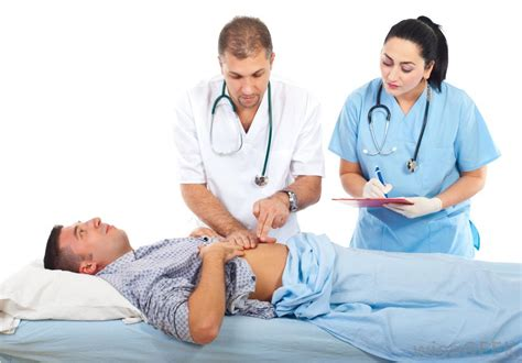 female doctor examines man for a hernia picture 1