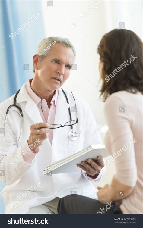 female doctor exmines male picture 11