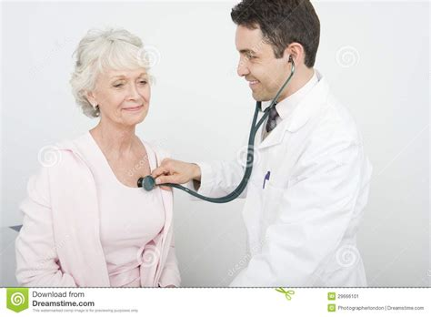 female doctor checking s picture 1