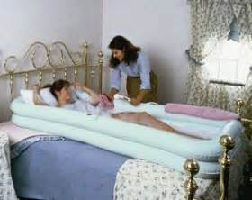 two nurses give male patient a sponge bath picture 11
