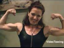 touch feel female biceps flexing picture 6