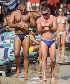male bulge touch in the beach picture 7