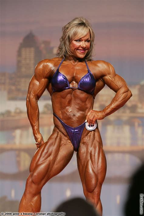 muscular female bodybuilder ing two guys picture 9