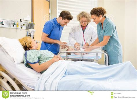 female doctor examining picture 10