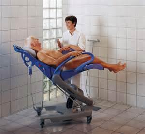 two nurses give male patient a sponge bath picture 8