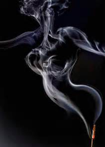 photographs of writings in smoke picture 10