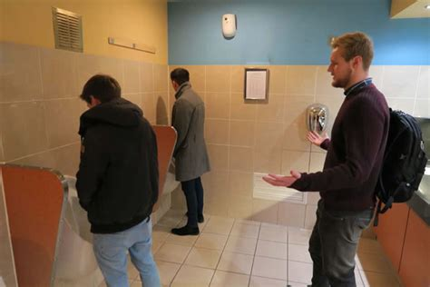 man with huge bladder at urinal picture 14