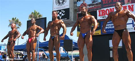 muscle men on beach picture 1