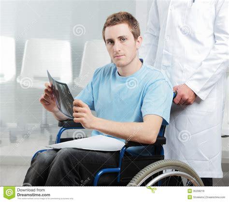 a nurse bathing a male patient. picture 11