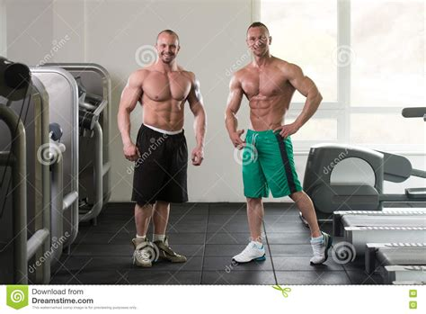 muscular female bodybuilder ing two guys picture 1