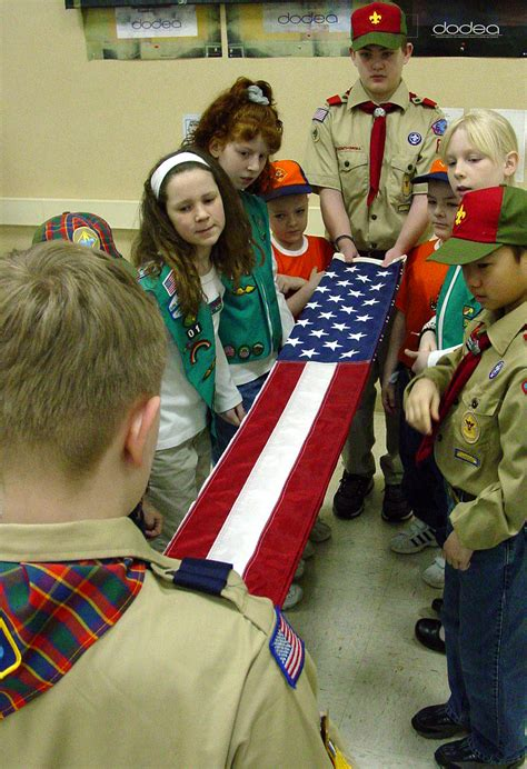 a boy from the scouts asked to touch picture 12