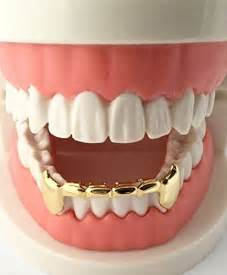 10k iced out dracula teeth picture 17