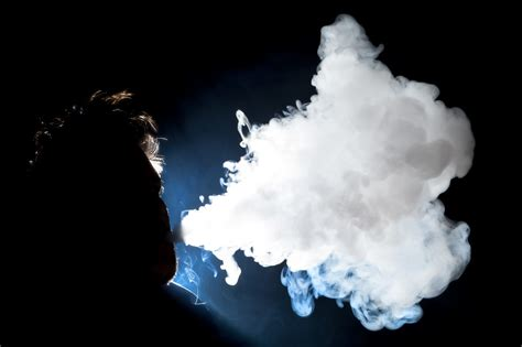 woman in cloud of cigarette smoke picture 9