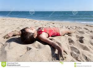 girls sleeping on beach picture 1