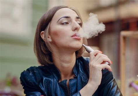 woman in cloud of cigarette smoke picture 6