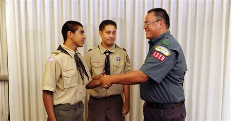 a boy from the scouts asked to touch picture 13