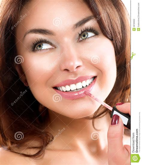 womens lips wearing lip gloss picture 1