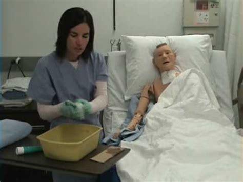 a nurse bathing a male patient. picture 9