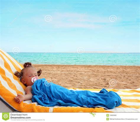 girls sleeping on beach picture 1