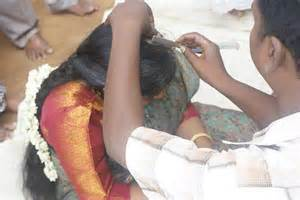 indian women shaving head picture 2
