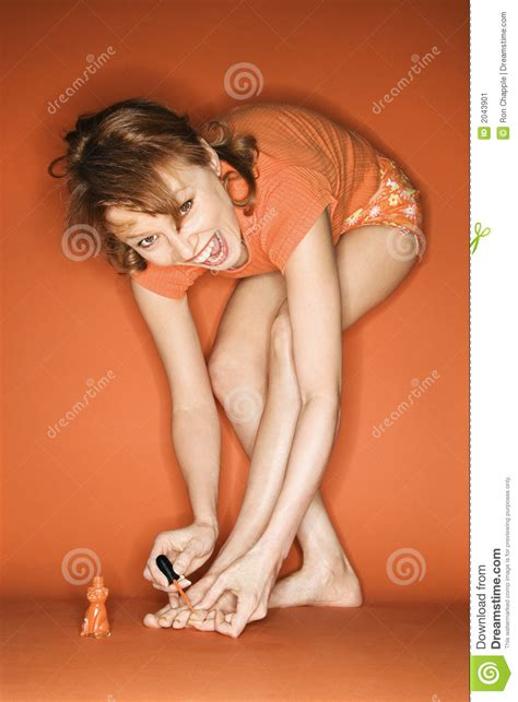 painting your toenails with nail polish. gets no picture 14