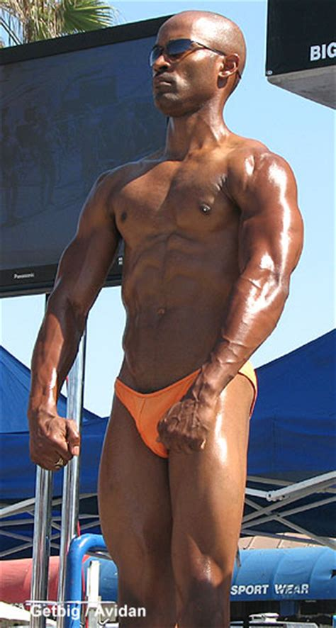 muscle men on beach picture 3
