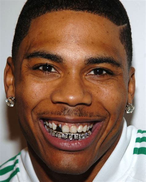 nelly takes gold tooth out picture 5