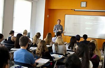 Image result for images of teacher with class in classroom