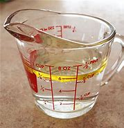 Image result for water in a messuring cup