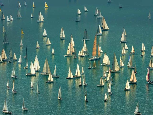 Boats massing for the Barcolana regatta in the Gulf of Trieste, Italy (© Ababsolutum/E+/Getty Images)